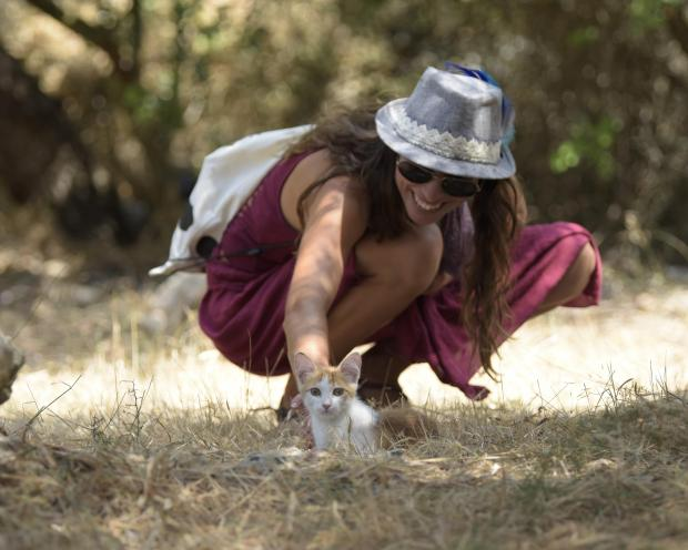 A woman pets a Kitten at the compost festival in Mgarr on July 16. Photo: Mark Zammit Cordina