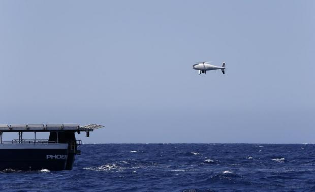An unmanned aerial vehicle (UAV) lifts off from the flight deck of the Phoenix, the expedition vessel of the Migrant Offshore Aid Station (MOAS) project, off Malta, during the vessel's first 20-day mission on August 25. Photo: Darrin Zammit Lupi