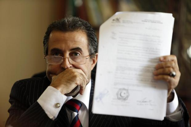 Hussin Musrati, representing Libya's Tripoli-based National Salvation Government displays documents during a press conference at the Libyan embassy in Balzan on December 20. Musrati accused the Maltese government of dabbling in Libyan affairs by not recognising the NSG as the official government of Libya. Photo: Darrin Zammit Lupi