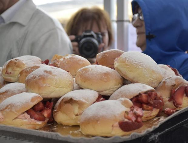A photographer takes a picture of burger buns filled with strawberries at the Strawberry Feast in Mgarr on April 10. Photo: Mark Zammit Cordina