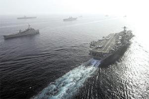Nine US warships carrying 17,000 personnel sail in the Gulf in this photo released by the US Fifth Fleet in Bahrain. The warships sailed through the narrowest point in the Gulf in broad daylight yesterday to hold drills off Iran`s coast in a major show of force that unnerved oil markets. US Navy officials said Iran was not notified of plans to sail nine ships, including two aircraft carriers, through the Straits of Hormuz, a narrow channel in international waters off Iran`s coast and a major artery for global oil shipments.