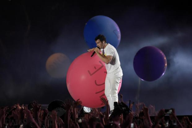 Artist Joe Jonas from band DNCE holds a bouncing ball during his performance at the Granaries in Floriana at the Isle of MTV Festival on June 27. Photo: Mark Zammit Cordina