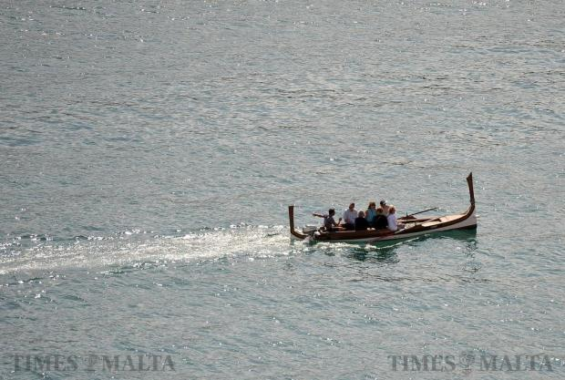 A 'dghajsa tal-pass' ferries tourists across Grand Harbour on October 12. Photo: Chris Sant Fournier