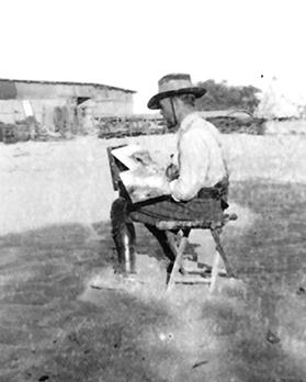 Informal portrait of official war artist George Lambert at work sketching outdoors activities of Allied forces, 1918. Artist unknown.