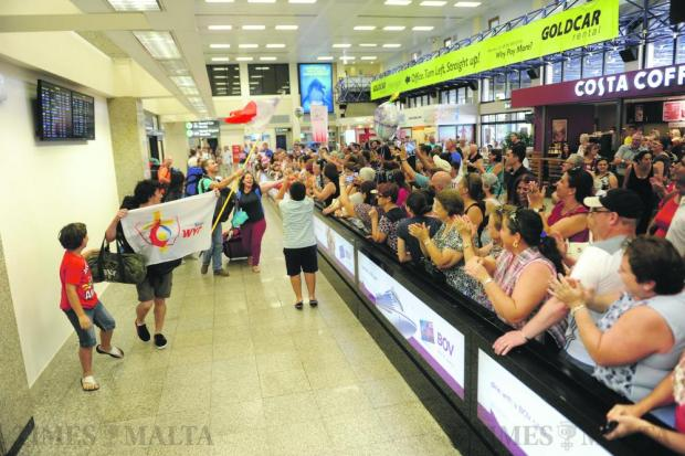 Families and friends welcome Maltese youths returning to Malta on August 1, after attending World Youth Day celebrations in Krakow, Poland. Photo: Steve Zammit Lupi