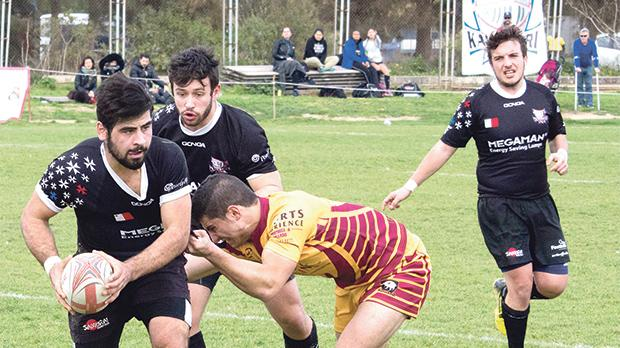 Kavallieri launch an attack against Falcons at the Marsa rugby ground. Photo: Ian Stilon