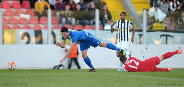 It's a red... Hibernians goalkeeper Jurgen Borg was dismissed for his late challenge on Tarxien's Luke Montebello during their Premier League derby match at the Hibs Stadium in Paola on December 12. Photo: Matthew Mirabelli