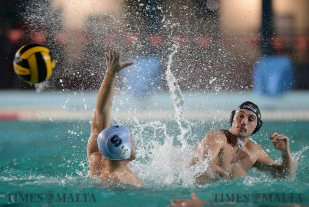San Ġiljan's Andreas Gales shoots at goal despite Sliema's Michael Cordina's attempting to block him during their BOV Winter League match at the National Pool in Tal-Qroqq on April 4. Photo: Matthew Mirabelli