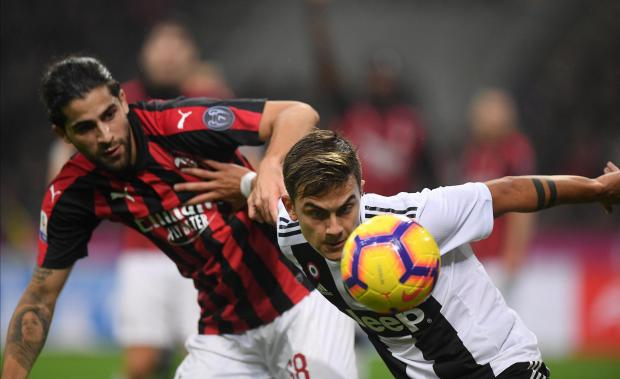 Milan's Rodriguez and Juventus' Dybala (right) battle it out for possession.