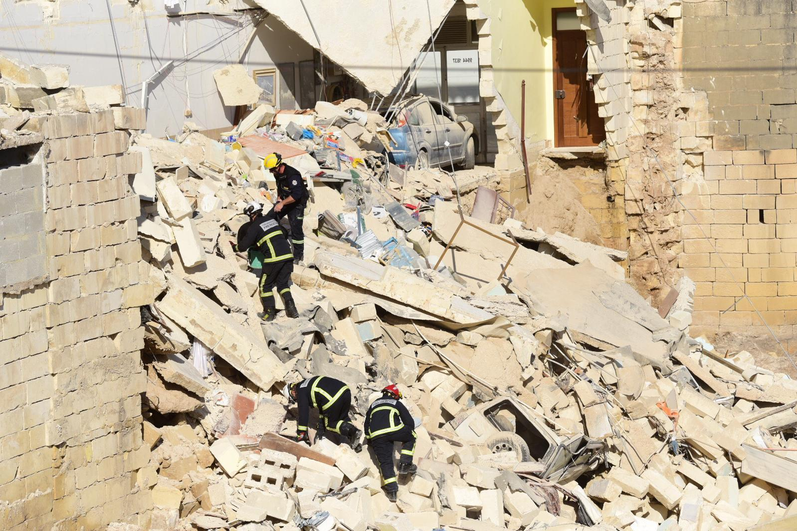 Rescue workers in the rubble on Monday afternoon. Photo: Mark Zammit Cordina