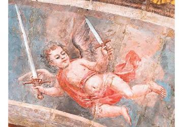 An angel holding aloft the sword and dagger of Grand Master Jean De Valette. Photos: Daniel Cilia