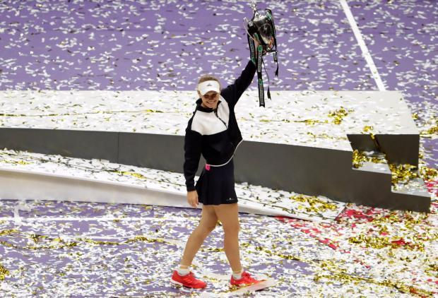 Denmark's Caroline Wozniacki celebrates with the trophy after winning the final against USA's Venus Williams.