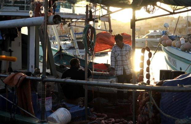Fishermen have a chat aboard their trawler at Marsaxlokk on January 14. Photo: Chris Sant Fournier