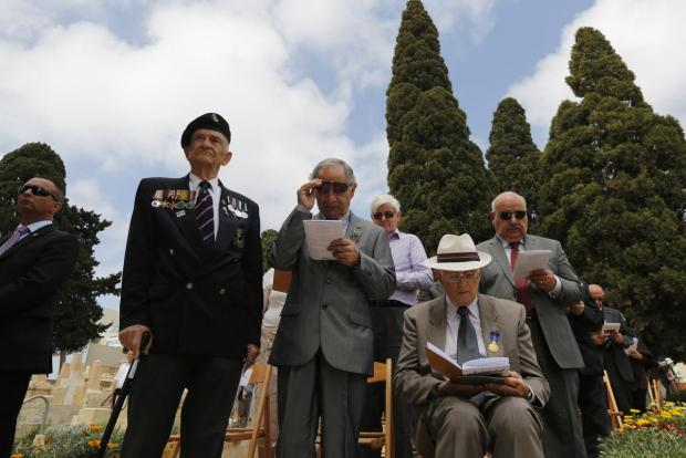 Military veterans take part in a service to mark the 100th anniversary of ANZAC (Australian and New Zealand Army Corps) landings at Galllipoli, at the Pieta Military Cemetery in Pieta on April 25. The Gallipoli campaign has resonated through generations, which have mourned the thousands of soldiers from the ANZAC cut down by machinegun and artillery fire as they struggled ashore on a narrow beach. The fighting would eventually claim more than 130,000 lives, 87,000 of them on the side of the Ottoman Turks, who were allied with imperial Germany in World War One. Photo: Darrin Zammit Lupi