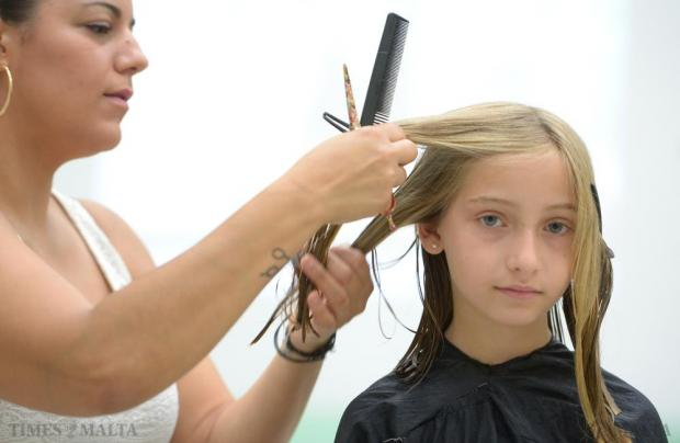 Seven-year-old Anastasia Zarb has her long hair cut during the 'Dare with your hair' event at the Msida Primary School on June 28. The collected hair will be made into wigs for those who have experienced hair loss due to a medical condition. Photo: Matthew Mirabelli