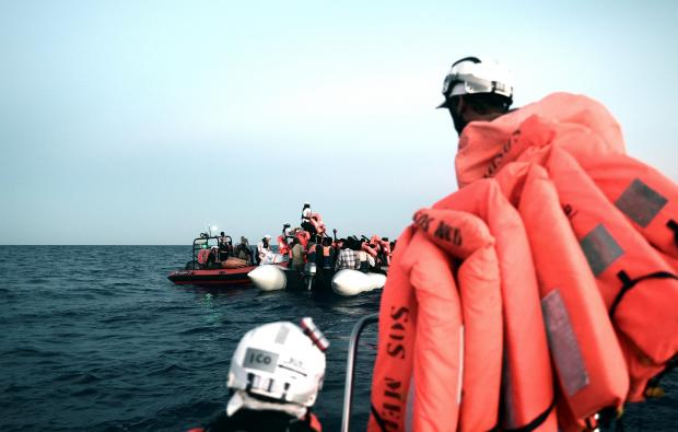 Migrants are rescued by staff members of the MV Aquarius.