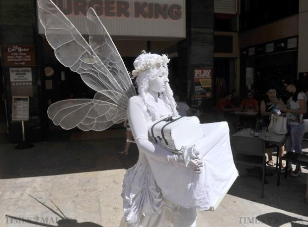 A busking fairy looks for a good busking spot ahead of a day's work in Republic Street Valletta on July 29. Photo: Chris Sant Fournier
