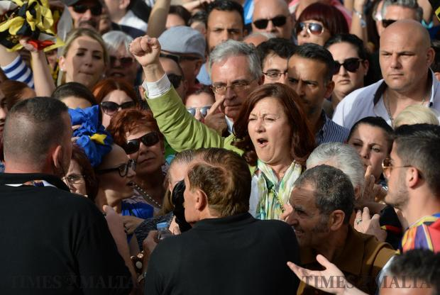 Partit Demokratiku candidate, Marlene Farrugia makes her way through the crowd at the PN mass meeting in Balzan on May 7. Photo: Matthew Mirabelli