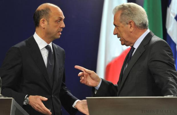 Italian Minister for Home Affairs Angelino Alfano, left, and European Commissioner for Migration Dimitris Avramopoulos address each other during a press conference on April 23, held following a funeral for 24 migrant victims. Photo: Jason Borg