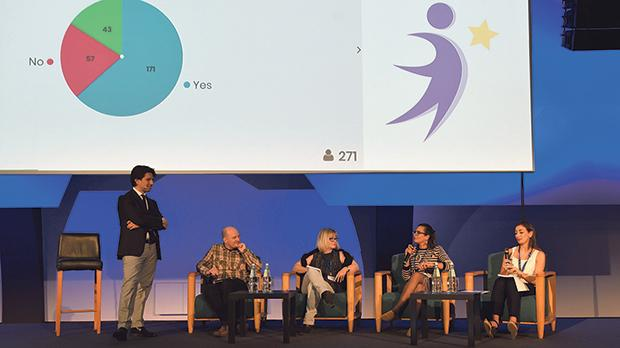 A panel discussion during one of the conference's plenary sessions on how to turn inclusion into action.