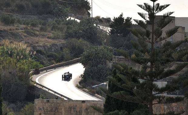 A car competing in the Mdina Grand Prix climbs back towards Mdina on October 8. Photo: Chris Sant Fournier