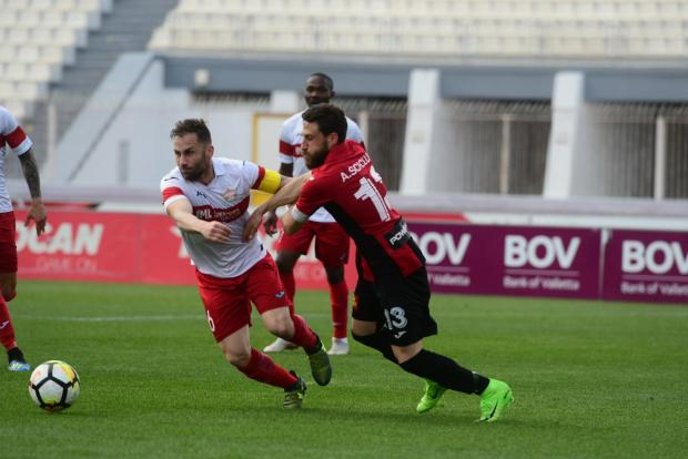 Balzan's Paul Fenech (left) tussles for the ball with Andre Scicluna of Ħamrun Spartans. Photo: Jonathan Borg
