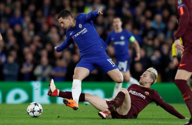 Eden Hazard is tackled by Ivan Rakitic, of Barcelona, at Stamford Bridge.