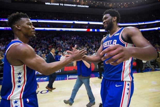 Philadelphia 76ers guard Jimmy Butler (23) and center Joel Embiid (21) celebrate a victory against the Boston Celtics at Wells Fargo Center. Mandatory Credit: Bill Streicher-USA TODAY Sports