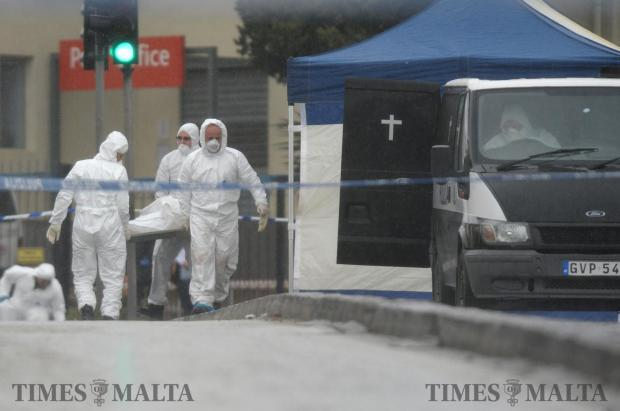 The body of 65 Victor Calleja, of Ħamrun is removed from the scene after the car he was in exploded after a car bomb was detonated on January 29. Photo: Matthew Mirabelli