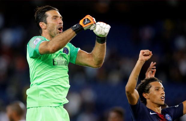 Paris St Germain's Gianluigi Buffon celebrate with team mates after the match.