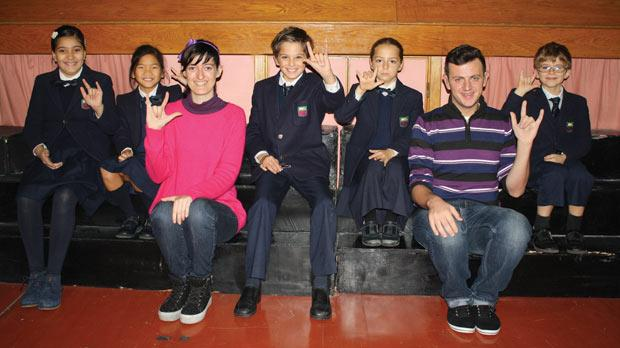 Emma Ripard and Loran Xuereb teaching sign language to some pupils.