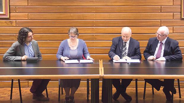 Dr Edward Duca, Dr Heather Rea, Prof. Alfred Vella and Prof. Saviour Zammit at the signing ceremony.