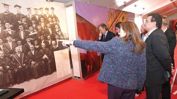 The past: University officials viewing a poster of an old photo of graduates.