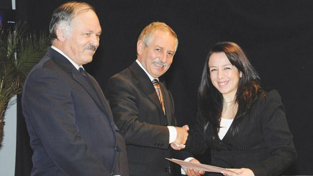 Prof. Maurice Grech presenting a certificate to Rebecca Galea. Also seen is Electrical and Electronics Engineering Institute director John Sciberras.