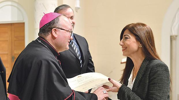 Archbishop Charles Scicluna presenting a certificate to actress and TV presenter Denise Mintoff. Photo: Curia Communications Office – INP