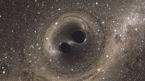 An artist's rendition of two merging black holes. PHOTO: The SXS
