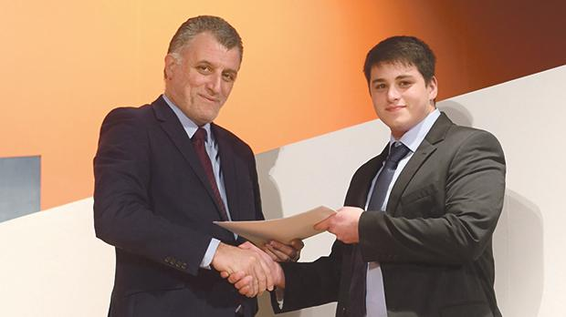 Mcast principal and CEO Stephen Cachia presenting a certificate to one of the graduates.