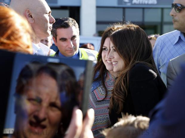Ira Losco poses for photos with waiting fans after arriving at Malta International Airport on May 15, after participating in the Eurovision Song Contest in Sweden. Photo: Darrin Zammit Lupi