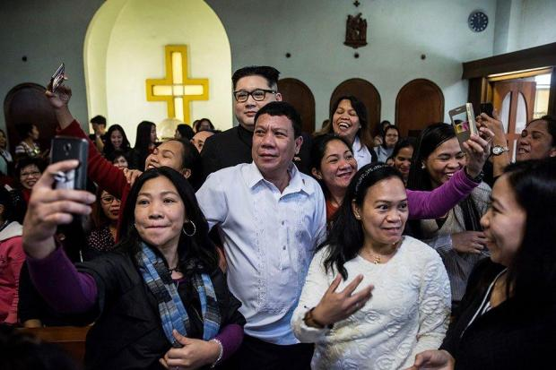 An impersonator of Philippine President Rodrigo Duterte (centre front) poses for photos in a Hong Kong church.