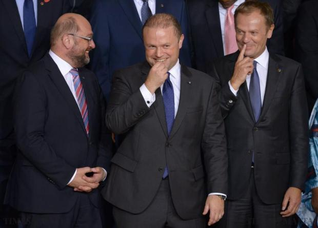 President of the European Parliament Martin Schulz (left) shares a light moment with Prime Minister of Malta Joseph Muscat (centre) and President of the European Council Donald Tusk (right) during the family photo at the Valletta Migration Summit in Malta on November 11. Photo: Matthew Mirabelli