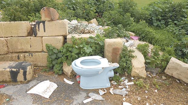 All sorts of waste is being dumped in the street, even a porcelain toilet base.