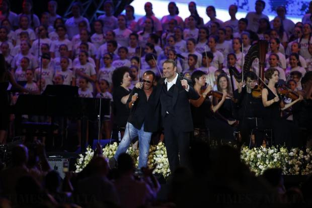 Special guest Antonello Venditti joins Joseph Calleja on stage during his concert on the Granaries in Floriana on July 28. Photo: Darrin Zammit Lupi