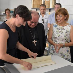Archbishop Charles Scicluna is shown the Papal document he is helping to restore. Photo: Mark Zammit Cordina