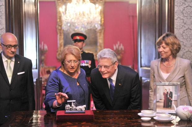 President Marie Louise Coleiro Preca and German President Joachim Gauck exchange gifts at the Palace in Valletta on April 29. Photo: Jason Borg