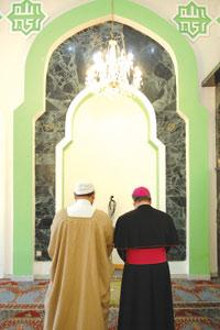 Archbishop Paul Cremona and Imam Mohamed El Sadi face Mecca as they pray together at the Corradino Mosque, sending a message on the importance of dialogue among faiths. Photo: Matthew Mirabelli.
