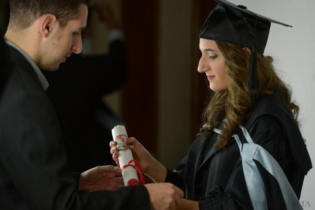 A graduate is prepared for her official photograph after graduating in Business and Information Technology at the University of Malta on November 23. Photo: Matthew Mirabelli