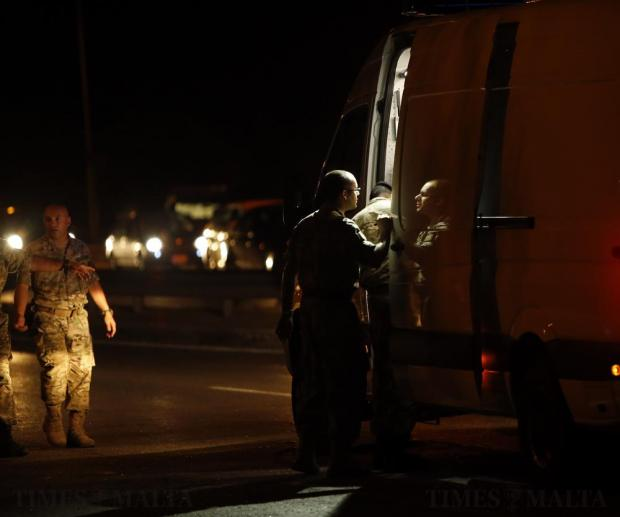 Armed Forces of Malta explosive ordnance disposal experts arrive on the scene of a bomb attack on a vehicle which left three people seriously injured on a busy road in Marsa on September 26. Photo: Darrin Zammit Lupi