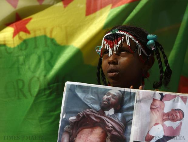 An Ethiopian child migrant and member of the Oromo community of Ethiopia living in Malta takes part in a protest against the Ethiopian regime outside Auberge de Castille in Valletta on June 16. The protestors called on Malta and the European Union to stop support for the Ethiopian regime and its plan to displace Oromo farmers. Late last year, the Ethiopian army evicted Oromo farmers from their ancestral land on the pretext of needing the land for an industrial zone, according to the protestors. Photo: Darrin Zammit Lupi