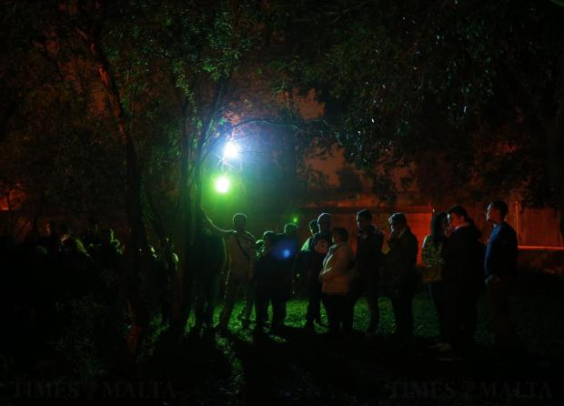 """Audience members watch the interactive street-theatre Passion play """"Il-Mixja"""" (The Way), one of a series of Holy Week activities in the run-up to Easter, in the grounds of Mount Carmel Mental Hospital in Attard on March 22. Photo: Darrin Zammit Lupi"""