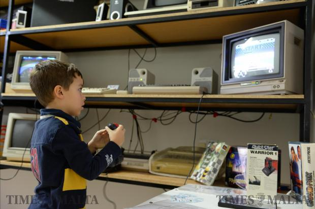 A young boy plays a game on a vintage computer at the Malta Vintage Computer Club in Attard on November 5, during its first open weekend treating the public to a display of retro games and old machines. Photo: Matthew Mirabelli